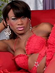 Wonderful black tgirl model in killer pink suit